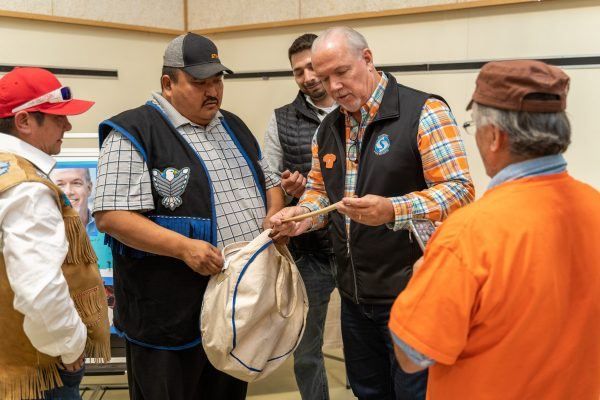 Premier Travels to Lower Post to Meet with First Nations, Visits Former Residential School, Oct 2019—Kaska drummers present Premier Horgan with a Kaska drumstick