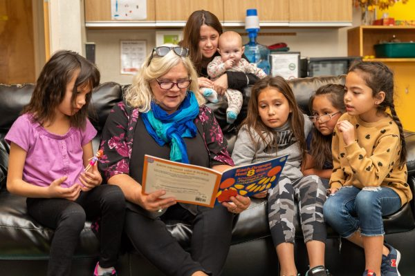 Premier Travels to Lower Post to Meet with First Nations, Visits Former Residential School, Oct 2019—Ellie Horgan with students at Denetia School, Lower Post