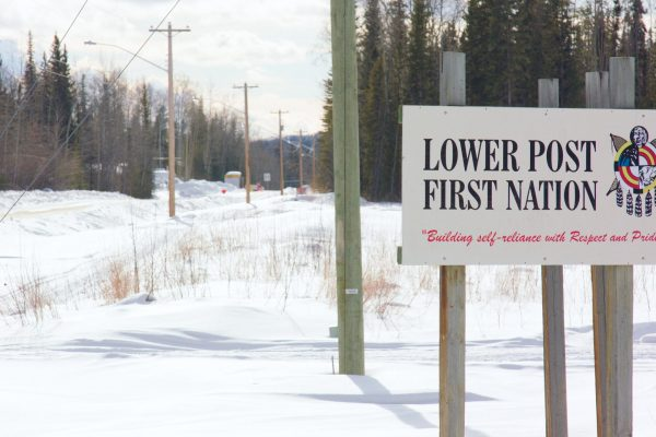 Lower Post First Nation—Building self-reliance with Respect and Pride sign; winter